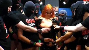 Redhead The Latex Queen in sexy stockings gangbang