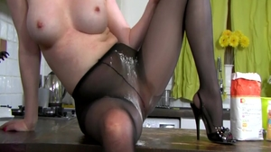 British Holly Kiss wearing pantyhose kissing each other