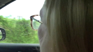 Fingering in car alongside beautiful teen wearing glasses