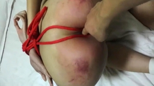 Chinese girl finds pleasure in bondage