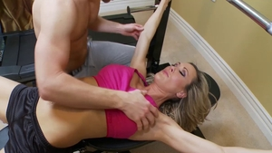 Muscled Brandi Love cock sucking at the gym