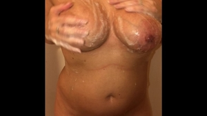 Busty amateur masturbation in the shower solo