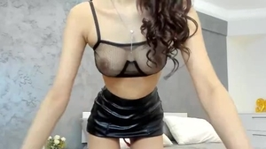 Fingering on live cam between babe wearing latex