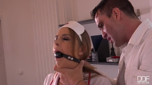 Hardcore BDSM amongst pornstar Nikki Miller in the clinic
